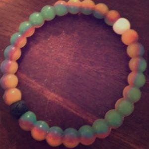 Brand new Rainbow Lokai size M
